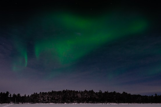 The Aurora Borealis seen from Lake Inari in Nellim, Finland located in the Arctic Circle.