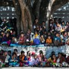 Bhutanese people gathered under a bodhi tree at the Punakha Tsechu Festival.